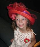 hailey in mom's red hat